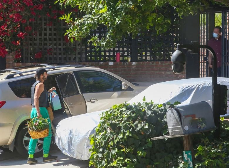 1621360565 385 Lady Gagas dog walker has resumed his duties with the
