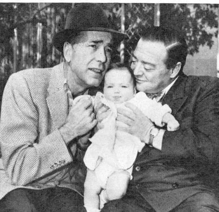 Little Catharine flanked by Humphrey Bogart and her father