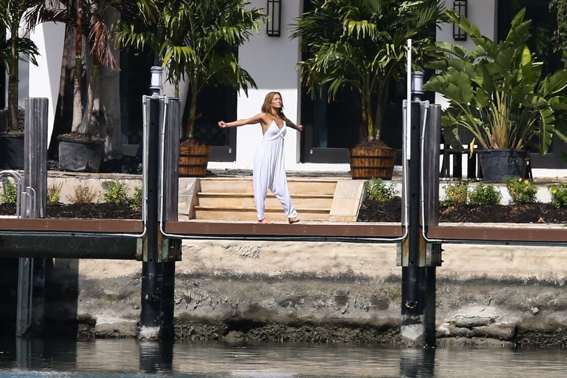 Jennifer Lopez does barefoot stretches outside the house she shares with Ben Affleck in Miami on May 25, 2021