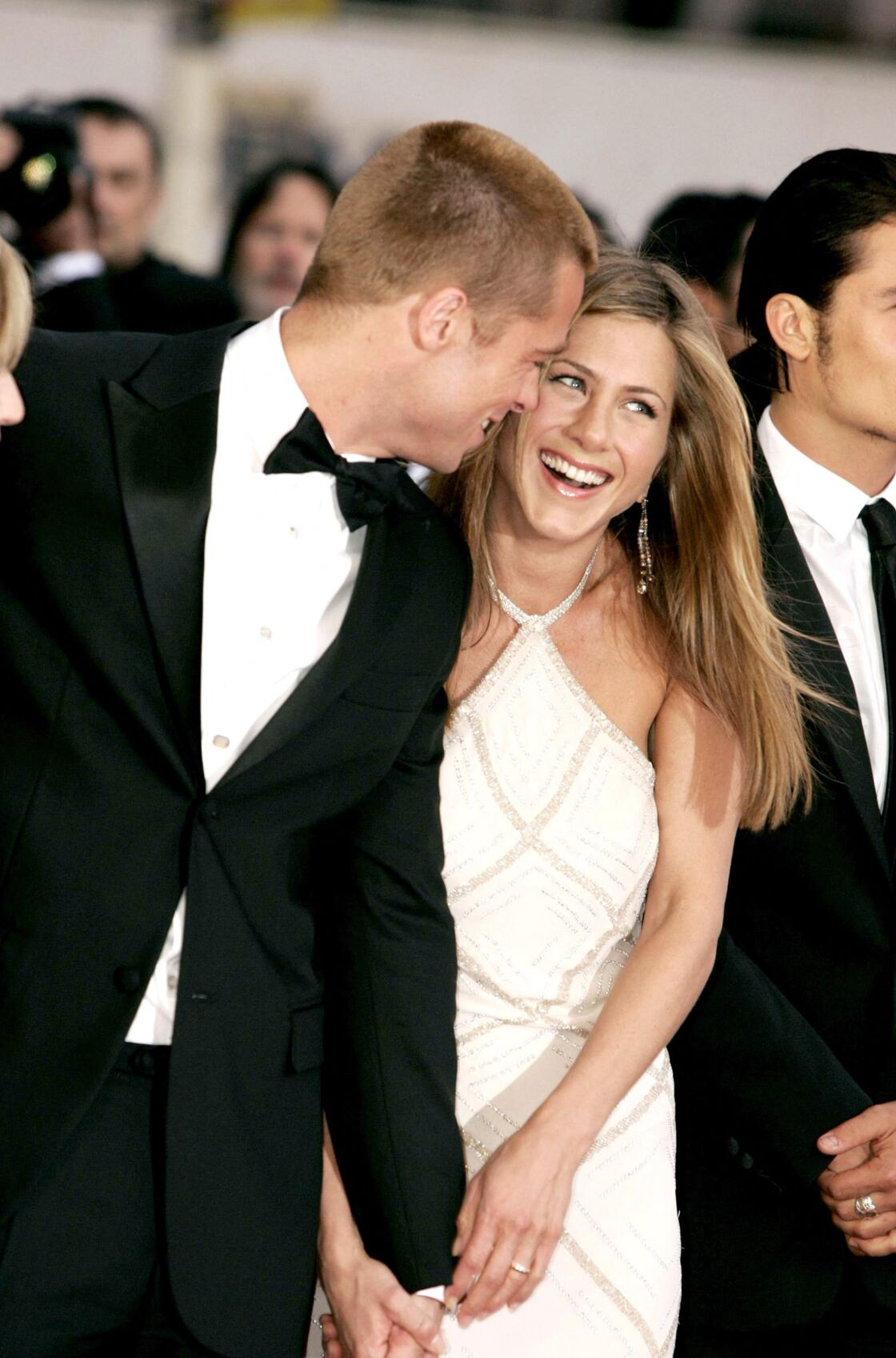 In Cannes in 2004, Brad Pitt does not let anything show through the arm of Jennifer Aniston.