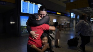 1623245914 A migrant mother is reunited with her daughter after six