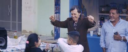 Dancing with children in the Sevillian neighborhood of Las Tres Mil Viviendas.