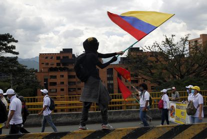 A citizen waves the Colombian flag during a protest against the government of President Iván Duque on May 26, 2021.