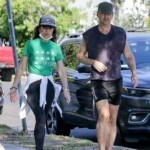 Colin Farrell shows off his strong legs while touring his Los Angeles neighborhood with his sister