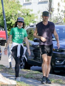 Colin Farrell shows off his strong legs while touring his