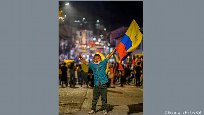 Boy carrying a Colombian flag in San Agustin, Colombia.
