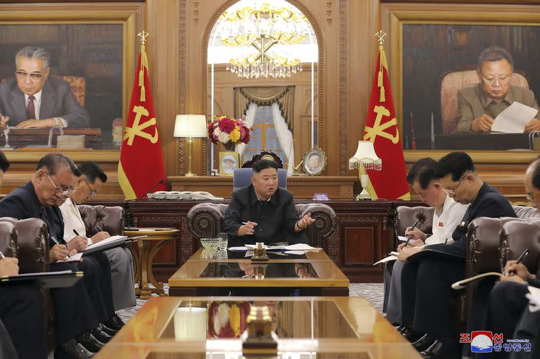 In this image, distributed by the North Korean government, the country's leader, Kim attends a meeting with senior officials of the ruling party on June 7