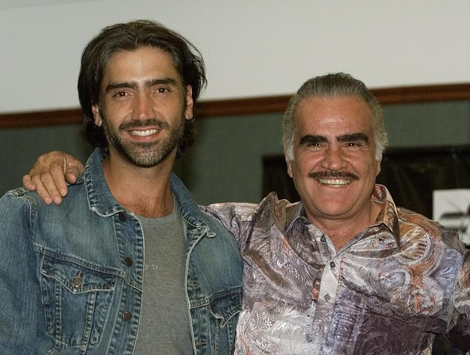 The father and son duo of Mexican singers Vicente (R) and Alejandro Fernandez, answer questions during a press conference in Bogota, June 10, 2003, Alejandro and Vicente Fernandez are on tour in Colombia. REUTERS/Daniel Munoz DM/GAC