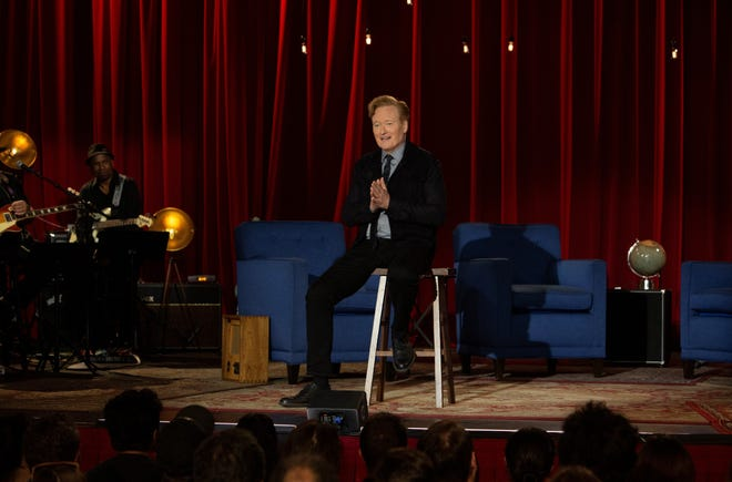 """Conan O'Brien, sitting on a stool the same way Johnny Carson did on his """"Tonight show"""" final, thank you """"Conan"""" staff and fans on the last episode of TBS's talk show."""