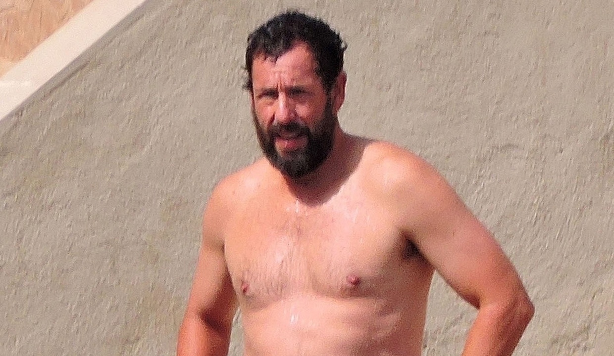 Adam Sandler hits the beach while on vacation in Spain while filming a new movie called Hustle