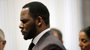 A woman testifies that singer R. Kelly promised her stardom in exchange for sex when she was a minor and then forced her to have an abortion