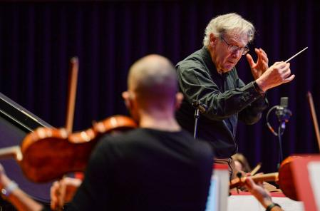 POOLE, ENGLAND - FEBRUARY 23: Conductor Sir John Eliot Gardiner rehearses with Bournemouth Symphony Orchestra on stage on February 23, 2021 in Poole, England. Bournemouth Symphony Orchestra returns in full to the stage at Lighthouse, Poole with Sir John Eliot Gardiner and pianist Stephen Hough; their concert broadcasts live viabsolive.comon Wednesday. (Photo by Finnbarr Webster/Getty Images)