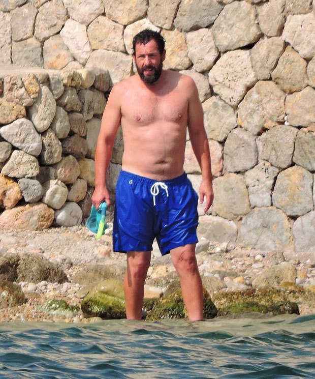Adam Sandler, 54, goes shirtless while snorkeling at a beach in Spain - photos - newsfeeds.