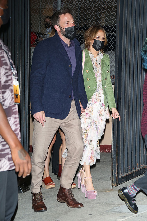 JLo and Ben Affleck hold hands as they bring the