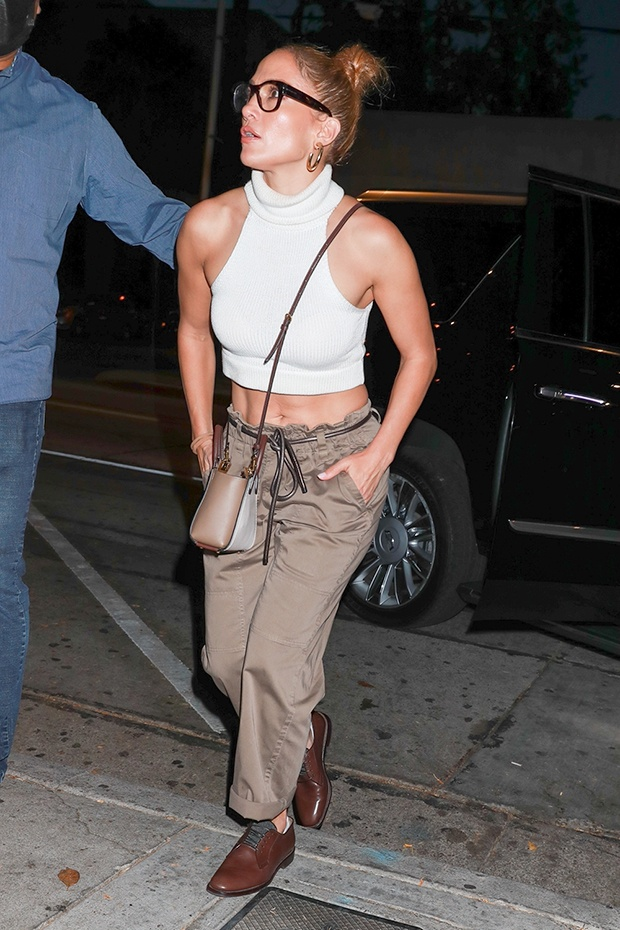 Jennifer Lopez reveals toned abs in strapless beige bandeau top and matching pantsuit - photos E! News UK