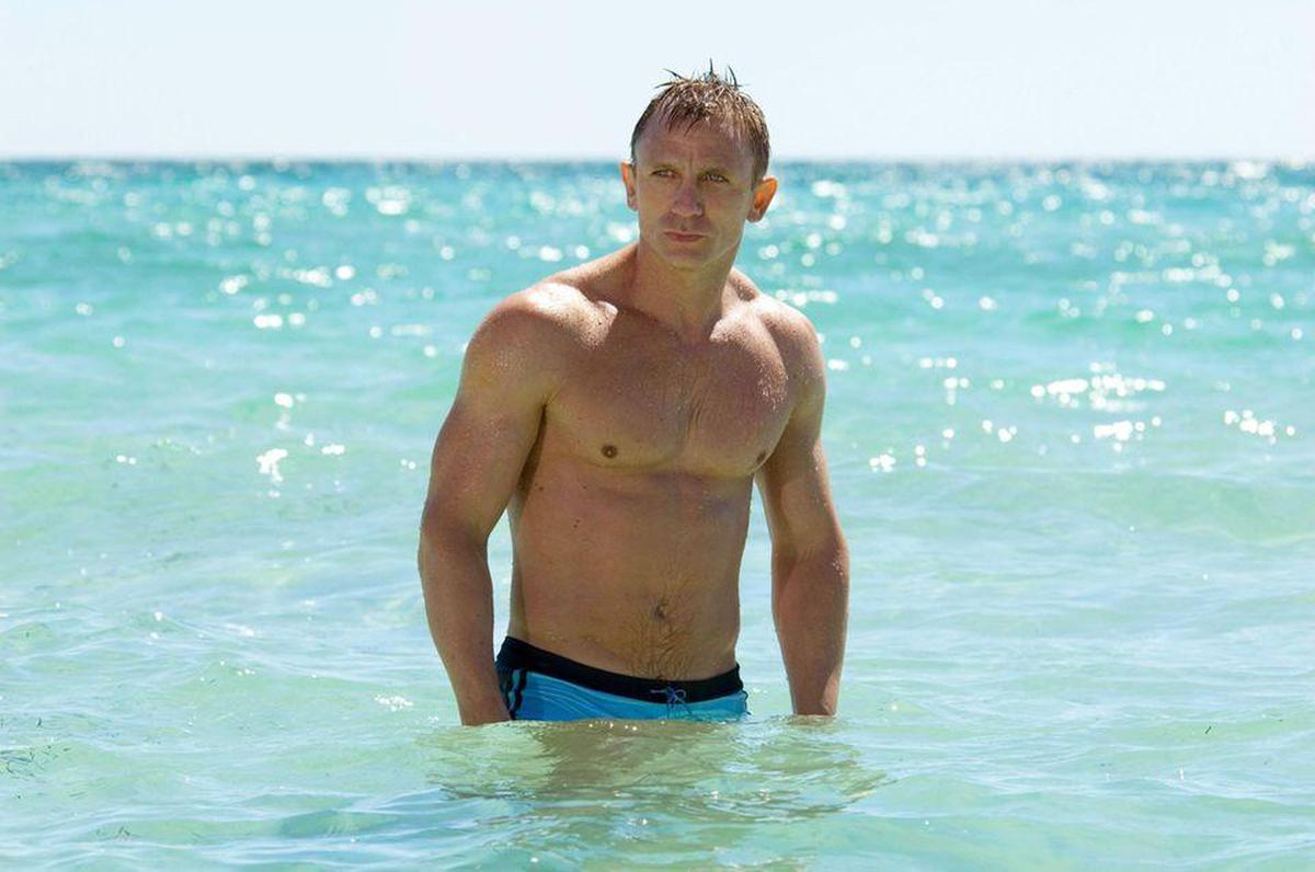Daniel Craig emerging from the waves in