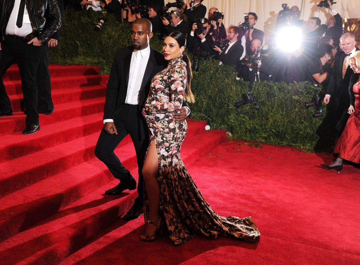 Kanye West and Kim Kardashian West posing at the 2013 Met Gala.