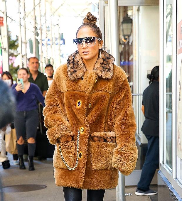 Jennifer Lopez bundles up in a Coach sheepskin coat worth