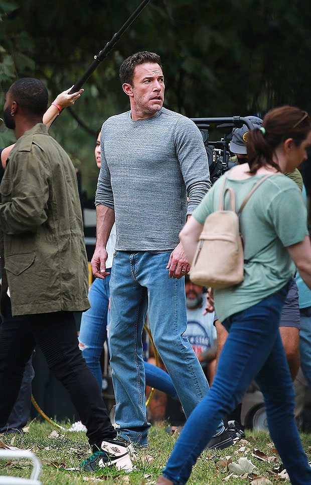 Ben Affleck shows off his big muscles while filming new