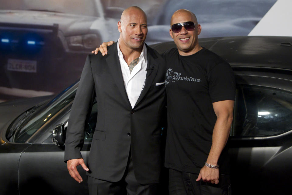 Dwayne Johnson (The Rock) and Vin Diesel (R) in 2011 in Rio de Janeiro. (Photo by Buda Mendes / LatinContent via Getty Images)