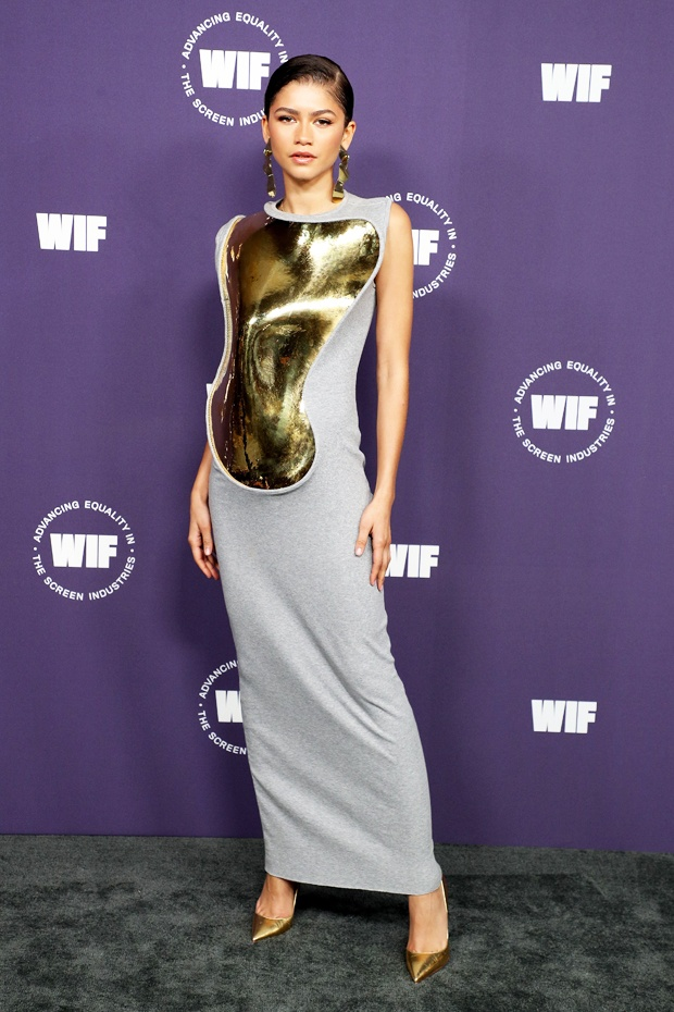 Zendaya stuns in bodycon dress with gold bib to women